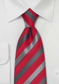 Silk tie, grey diagonal stripes on red fond