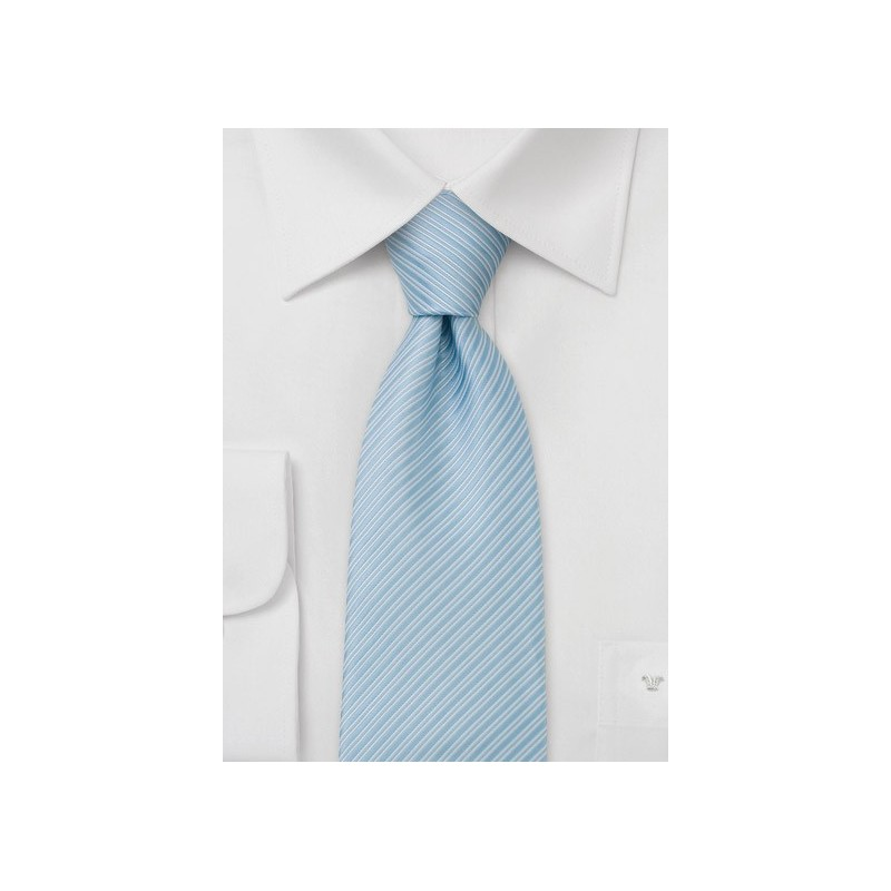 Electric blue necktie with fine stripes