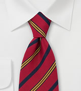 Atkinsons Club Tie  Blue and yellow stripes on red