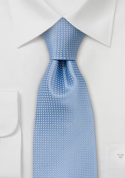 Spring and Summer tie<br>Solid colored light blue tie with fine pattern