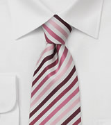 Narrow striped tie Tie in light pink, rose, and purple.