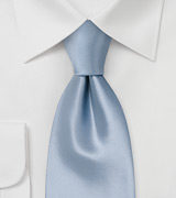 Solid colored light blue silk tie